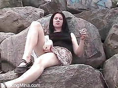 Upskirt in the park with the naughty smoking girl tubes