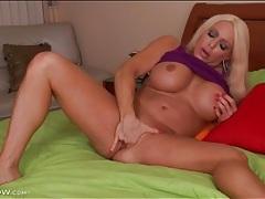 Big blonde milf shoves two fingers in her cunt tubes