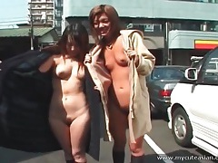 Two japanese girls flash their naked bodies in public tubes