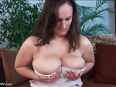 Cute brunette fondles her sexy big natural tits tubes