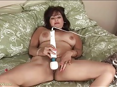 Mom uses two dildos to make her pussy cum tubes