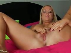Mom alone in bed masturbates her hot cunt tubes