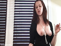 Beauty lifts black dress and flashes her milf pussy tubes