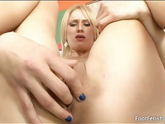 Blonde leans back and fingers her tight pussy tubes