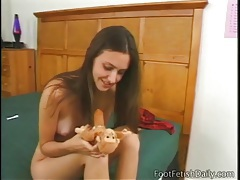 Cute brunette plunges dildo into her wet pussy tubes