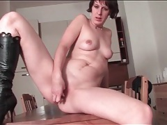 Sexy black leather boots look hot on fingering mom tubes