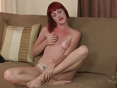 Redhead opens her coat and bares small tits tubes
