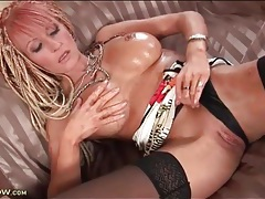 Edgy milf oils up her big sexy tits tubes