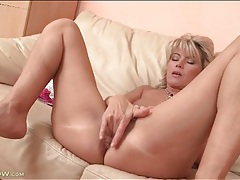 Cute blonde mature finger fucks cunt in close up tubes