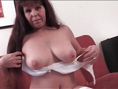 Sexy old lady in a pair of lovely white stockings tubes