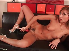 Tanned babe in silver high heels fucks a toy tubes