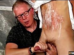 Old guy jerks off cute twink in bondage tubes