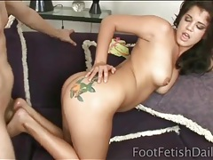 Naughty slut with a tattooed ass gives footjob tubes