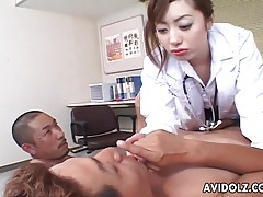 Japanese doctor gets frisky stroking his cock tubes