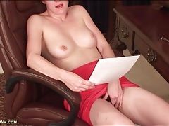 Mature hard at work shows her tits and panties tubes