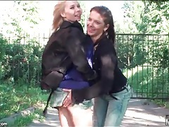Lesbian girlfriends on a walk enjoy kissing tubes