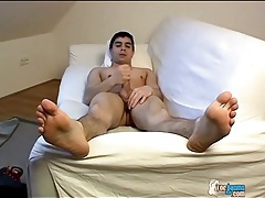 Naked young brunette guy jerks off his cock tubes