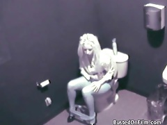 Bathroom camera captures girl masturbating on toilet tubes
