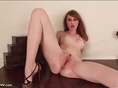 Redhead milf fingers pink cunt in close up tubes