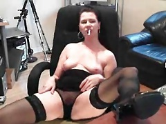 Webcam brunette in stockings and panties masturbates tubes