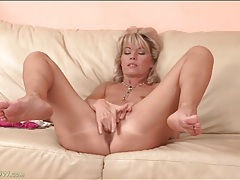 Naked milf spreads her legs and fingers her cunt tubes