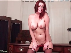 Beautiful curvy redhead strips on wooden desk tubes