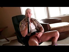 Sexy cop masturbates his big cock and toys his ass tubes