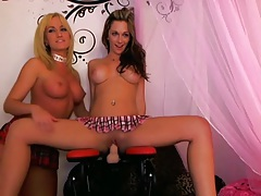 Two girls ride the dildo chair on webcam tubes