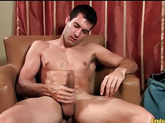 Sexy guy with cut arms strokes his uncut cock tubes