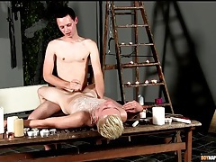 Hot wax punishment for twink in bondage tubes