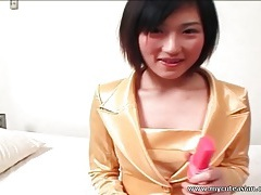 Shiny yellow satin suit on sultry japanese girl tubes