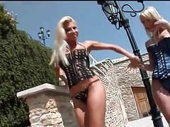Two leggy blonde babes in corsets outdoors tubes
