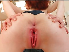 Slutty redhead in pleated skirt models her cunt tubes
