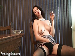 Dress and stockings are gorgeous on smoking girl tubes