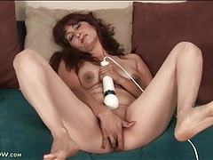 Mature with her legs open fucks a dildo tubes