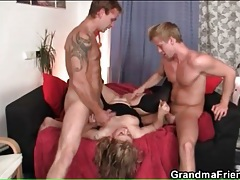 Chubby older lady fucks two guys in threesome tubes