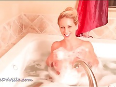 Blonde toy fucks wet pussy in the warm bath tubes