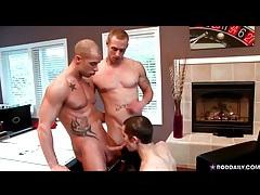 Slim guy on his knees sucking two dicks tubes