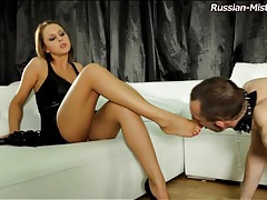 Lady in a leather dress abuses a sub guy tubes