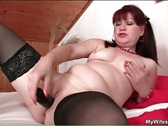 Sexy mature redhead toys her pussy for a guy tubes