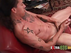 Solo tattooed guy masturbates his big uncut cock tubes
