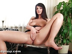 Busty babe uses her piss as lube for masturbation tubes