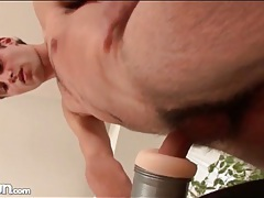 Hairy guy fucks fleshlight asshole toy tubes