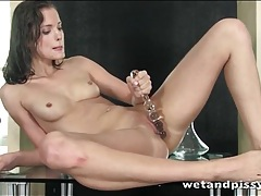 Beautiful brunette fucks wet cunt with a toy tubes