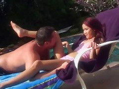 Pierced asian pussy eaten out by the pool tubes