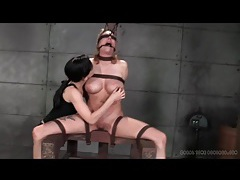 Couple plays with bound and abused girl in dungeon tubes