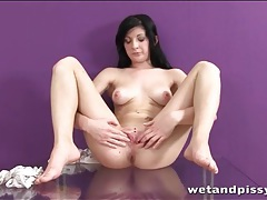 Teenager with breathtaking shaved pussy plays tubes