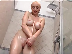 Blonde babe soaps up her body and masturbates tubes