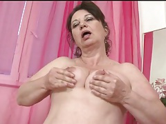 Mature fingers cunt and fucks a dildo tubes
