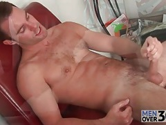 Masturbating solo guy cums on leather chair tubes